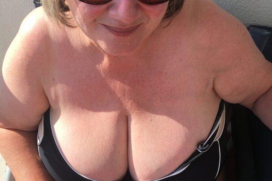 British fat mature masturbating in the sun