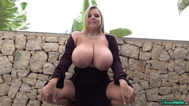 Busty blonde Polish model showing her boobs